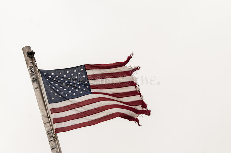 American Flag in disgraceful-condition,tattered,torn, royalty free stock images