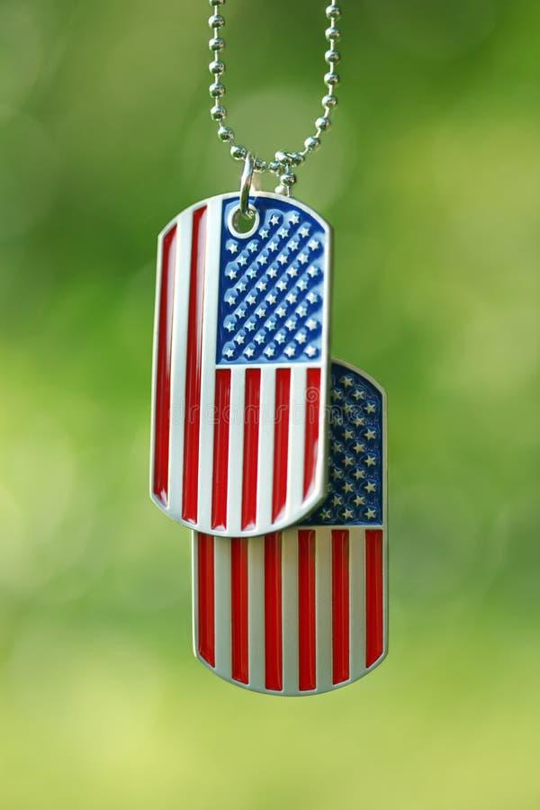 American flag dog tags hanging outside. USA American flag dog tags hanging outside royalty free stock image