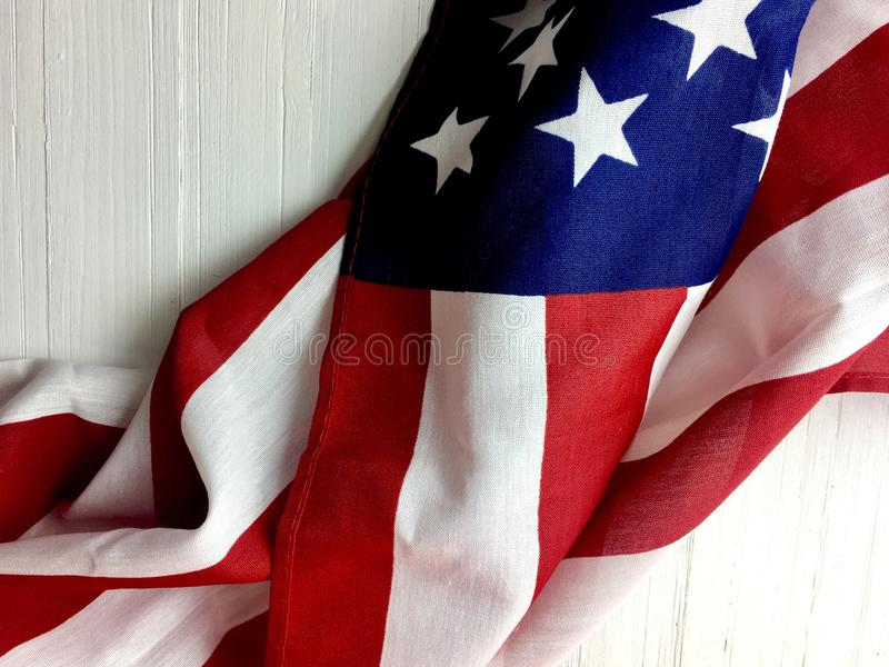 American flag. Draped across a rustic white wooden surface stock photos