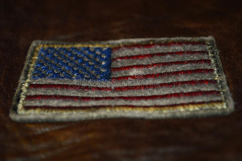 Beautiful rose in black and white color closeupAmerican flag embroidered on brown leather stock images