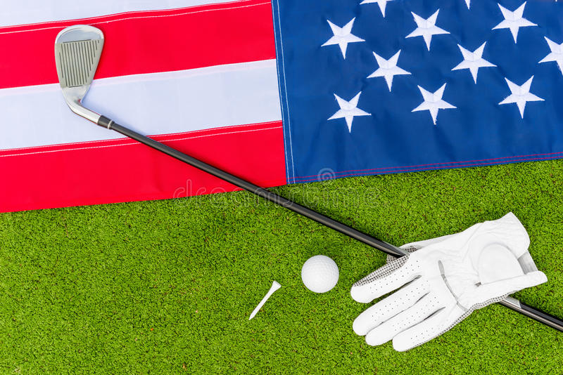 American flag and the equipment for golf. Top view - the American flag and the equipment for golf stock image