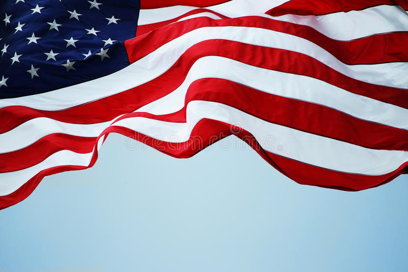 American Flag. An American flag flowing in the wind royalty free stock photo