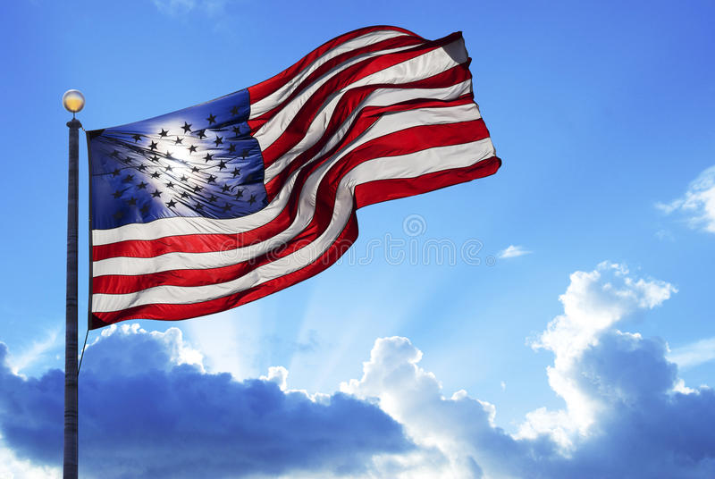 American flag. Fluttering in the wind under a cloudy sky