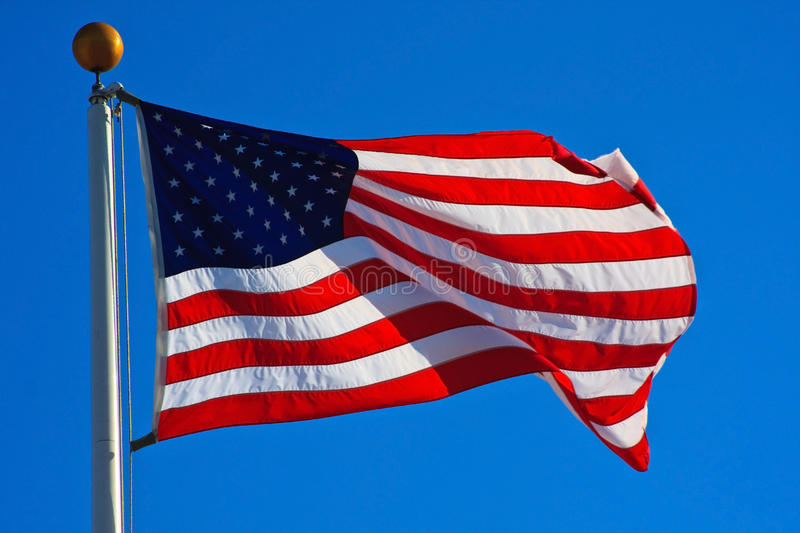 American Flag Flying. In a beautiful, clear day royalty free stock photo