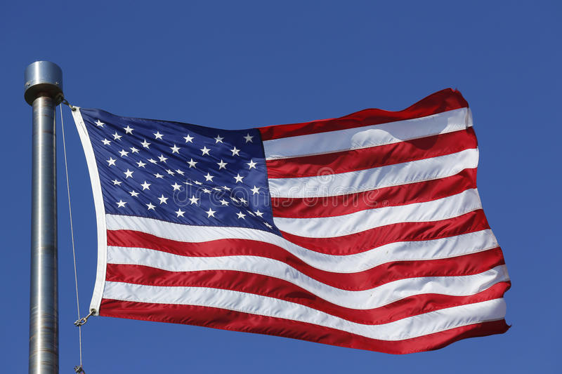 American flag. Flying high in New York royalty free stock photo