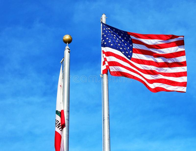 American flag. The American flag flying next to another flaccid flag royalty free stock photography