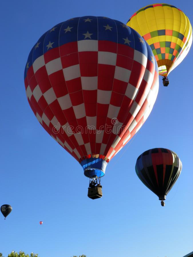 American Flag balloon flying the skies at the Albuquerque International Balloon Fiesta. American Flag flying over Albuquerque on a chilly morning the first stock image