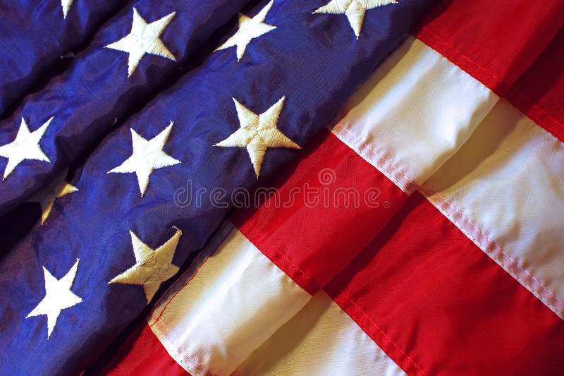 American flag. Folded in waves background stock photography