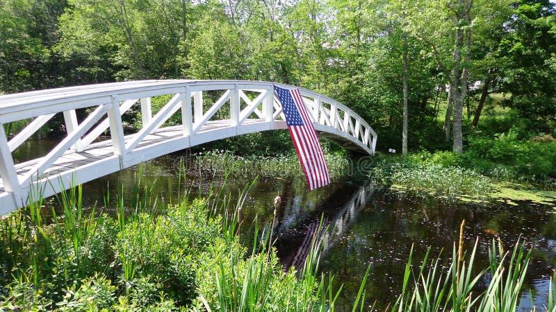 American flag on footbirdge. American flag hanging on footbridge in Bar Harbor Maine royalty free stock image