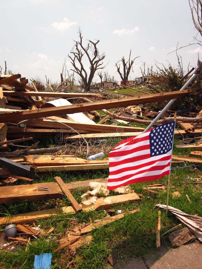 Tornado wreckage with American flag stock images