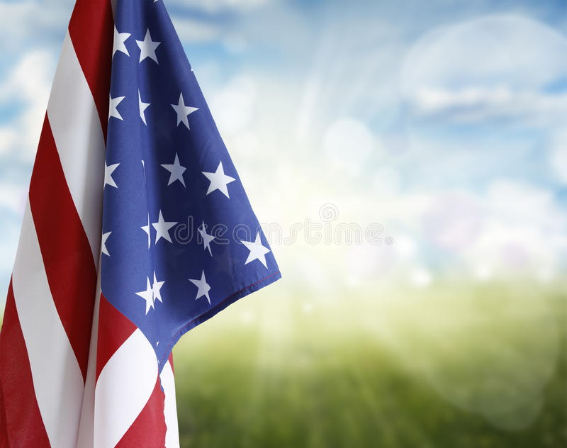 American flag. In front of blue and green background royalty free stock images