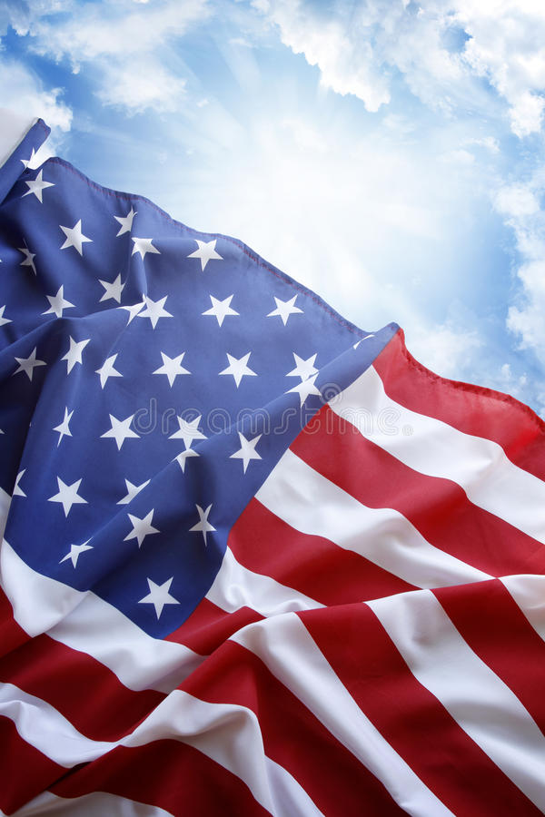 American flag. In front of blue sky royalty free stock photo
