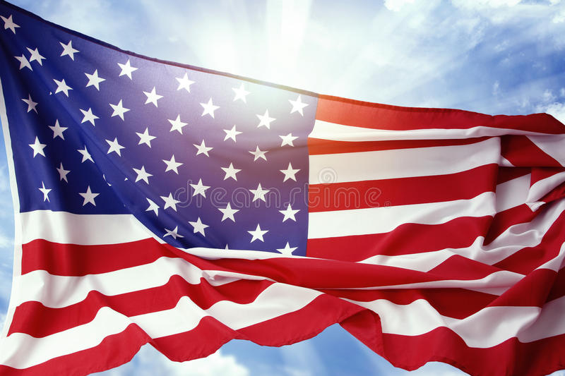 American flag. In front of blue sky stock photos