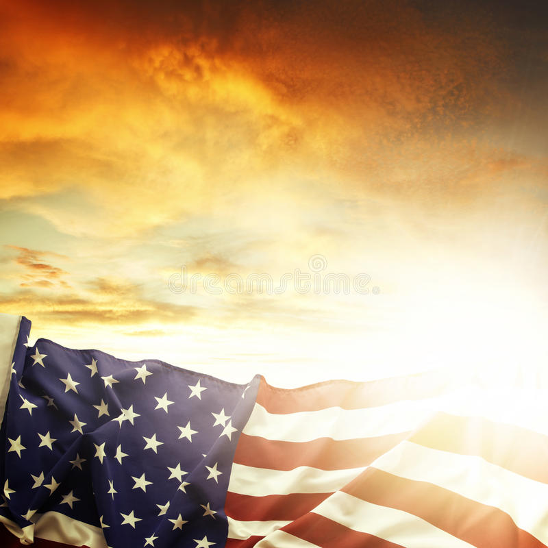 American flag. In front of bright sky royalty free stock photos