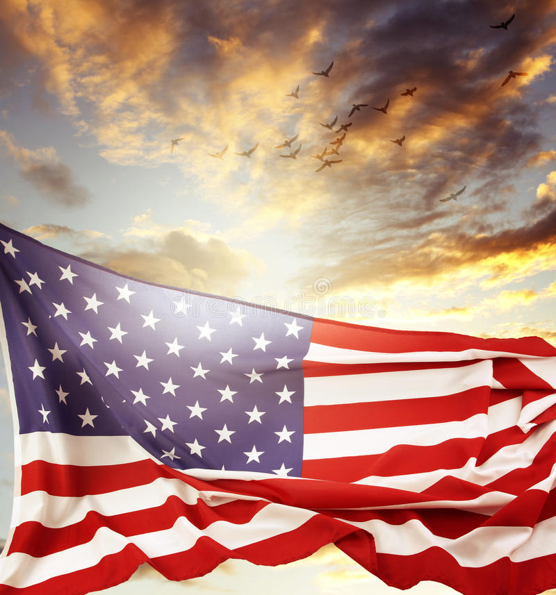American flag. In front of bright sky stock images