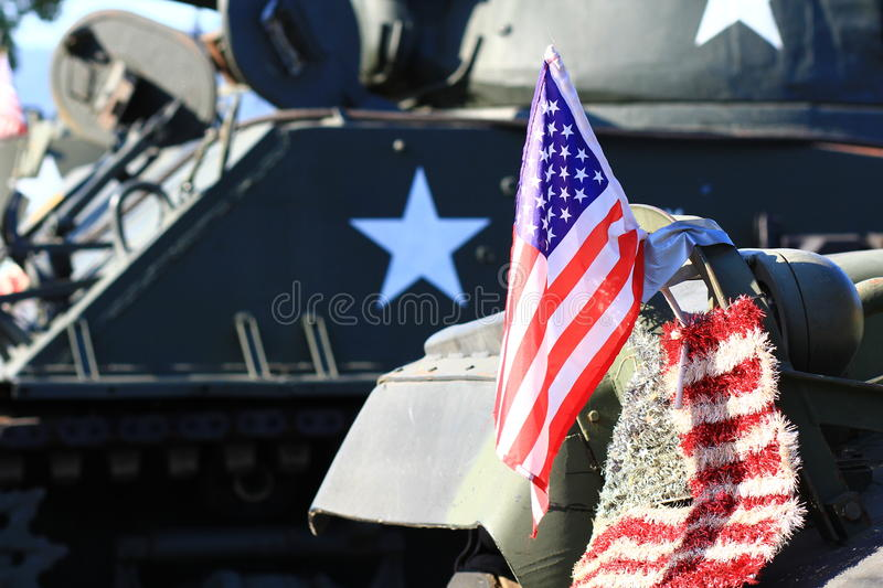 American Flag in front of tank. American flag resting on a military tank stock photo