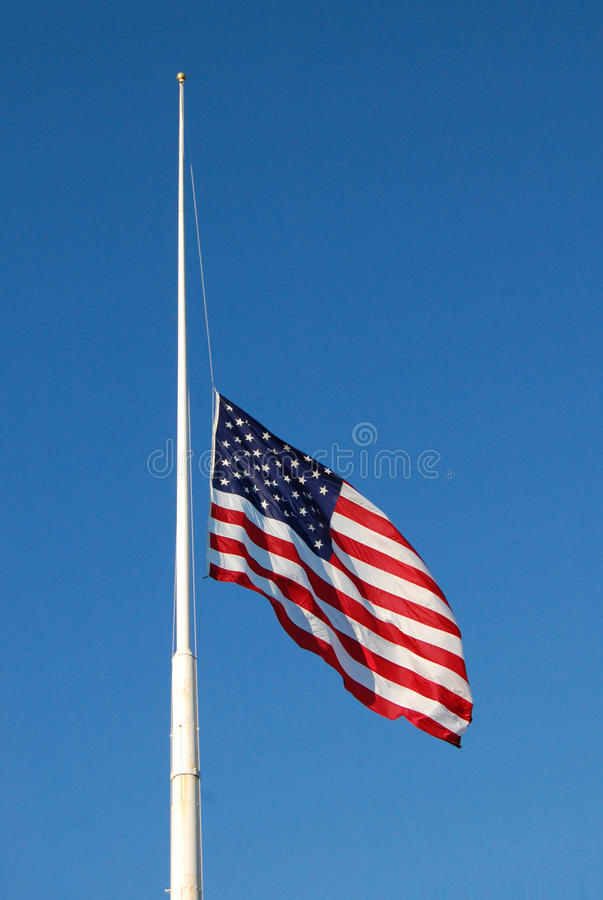 American flag at half mast stock photography