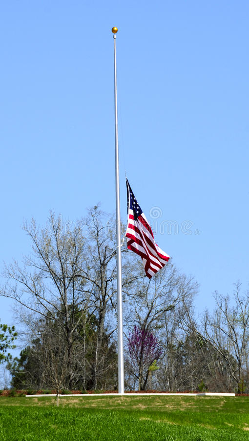 American flag at half mast stock image