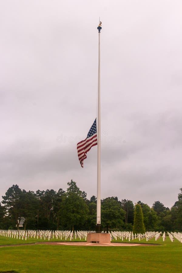 American flag half-mast at WW2 cemetery royalty free stock photos