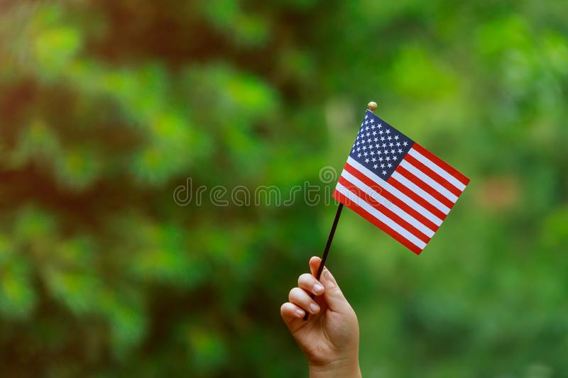 With american flag in her hand Independence Day, Flag Day concept. Beautiful american flag in her hand laughing on sunny day Independence Day, Flag Day concept stock images