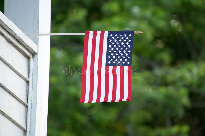 American Flag on house. American Flags sticking out from house royalty free stock photos