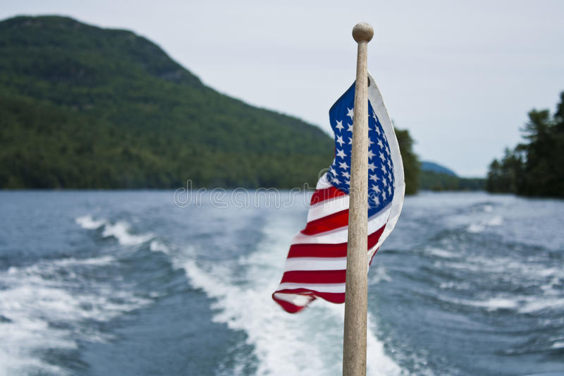 American Flag on Lake. American Flag flapping in the wind while boating stock image