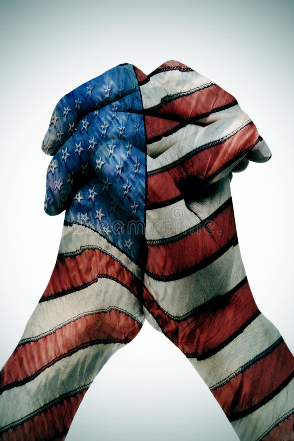American flag. Man clasped hands patterned with the american flag royalty free stock image