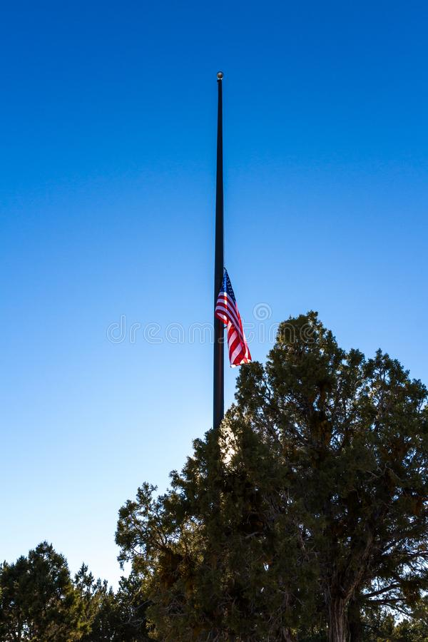 American Flag at half mast. An American flag in Mesa Verde NP flown at half mast honoring President Bush Senior after his death stock photography