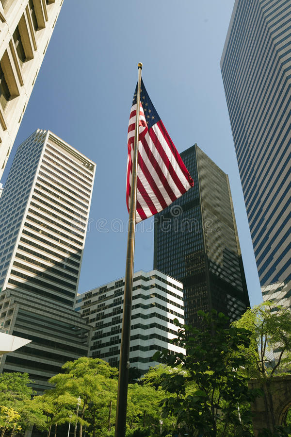 American Flag in the middle of skyscrapers royalty free stock image