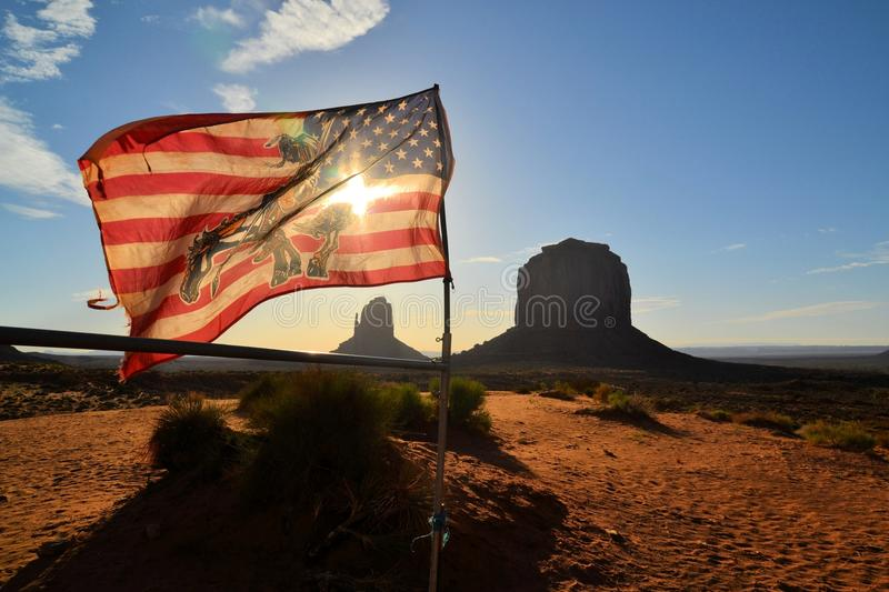 American Flag at Monument Valley. American Flag with Wild West sunrise at Monument Valley, Arizona USA stock photography