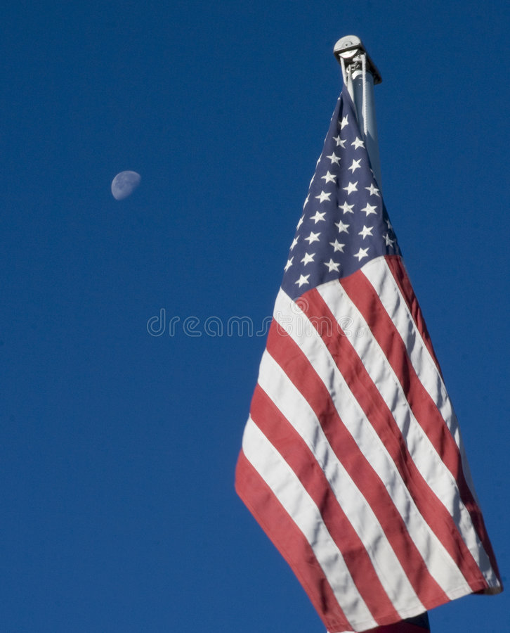 American Flag and Moon. The moon is a backdrop for this image of the American Flag stock photography