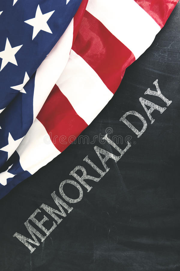 American flag near handwriting of memorial day royalty free stock image