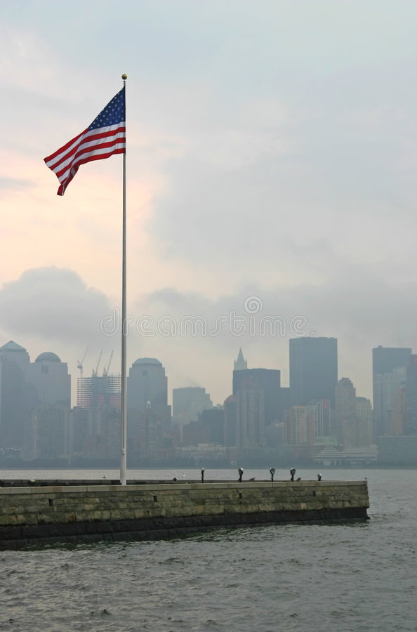 American Flag in New York. American Flag at Ellis Island with New York in background stock images