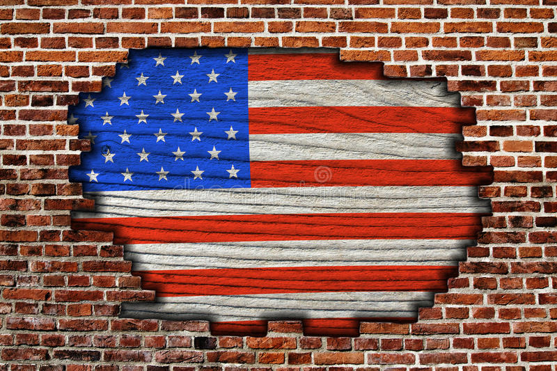 American flag on old brick wall stock images