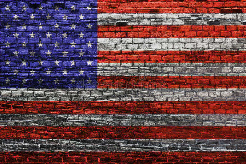 American flag on old brick wall. Texture or background stock photography