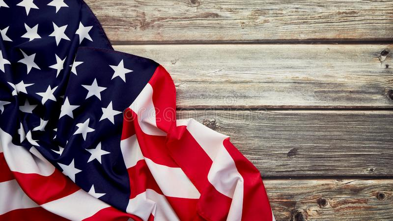 American flag on old rustic wooden board stock image