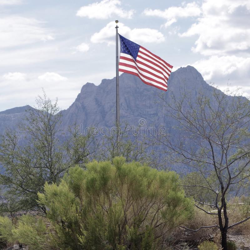 American Flag flying at Red Rock Conservation Area, Nevada USA stock photography