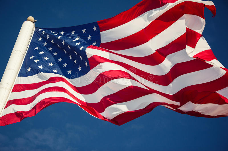 American flag over blue sky. Background royalty free stock photos