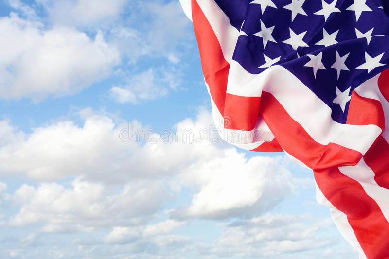 American flag over blue sky. Background stock photography