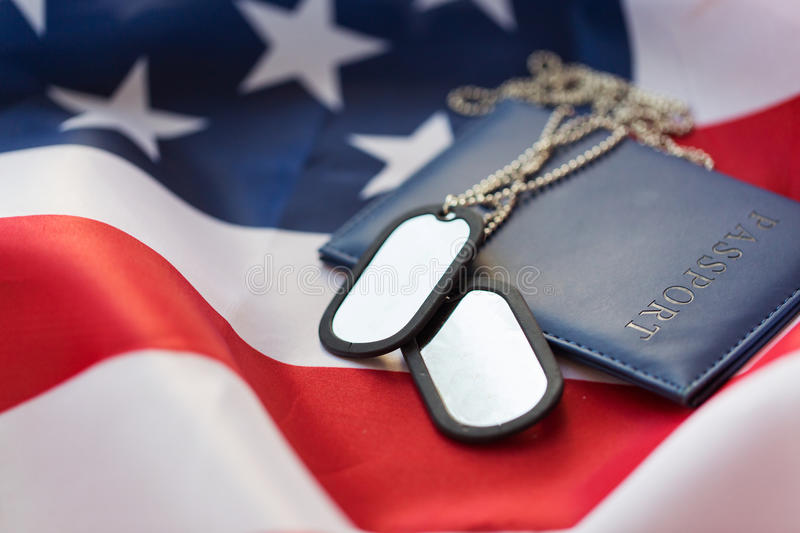 American flag, passport and military badge. Military forces, patriotism, recruitment and national service concept - close up of american flag, passport and stock images