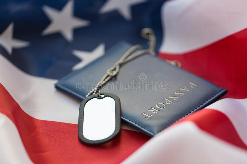 American flag, passport and military badge. Military forces, patriotism, recruitment and national service concept - close up of american flag, passport and royalty free stock photos