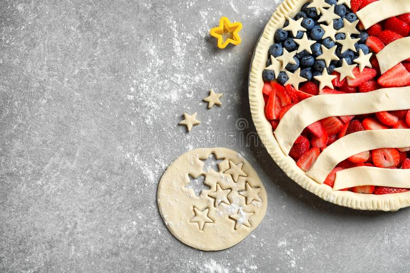 American flag pie. On grey background royalty free stock photo