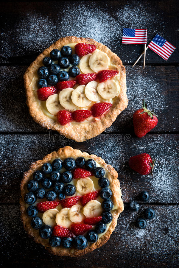 American flag on the pie. American flag on the top of pie with berry fruit and vanilla pudding stock photo