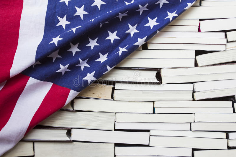 American flag and piles of books. American flag on piles of books stock images