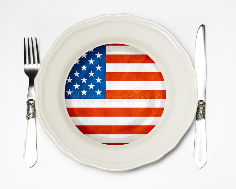 American flag on a plate. On a white table royalty free stock photos