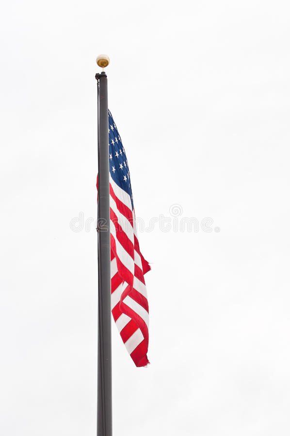 American flag on pole. American flag hanging on a pole during a calm day royalty free stock images