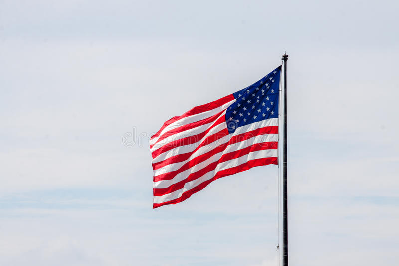 American Flag. On a flag pole stock photography