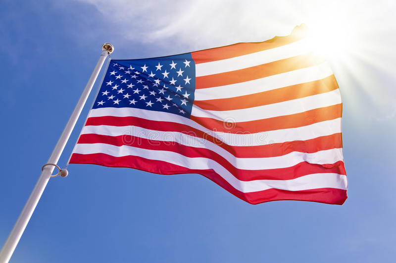 American flag. On a pole in a sunny sky stock photography