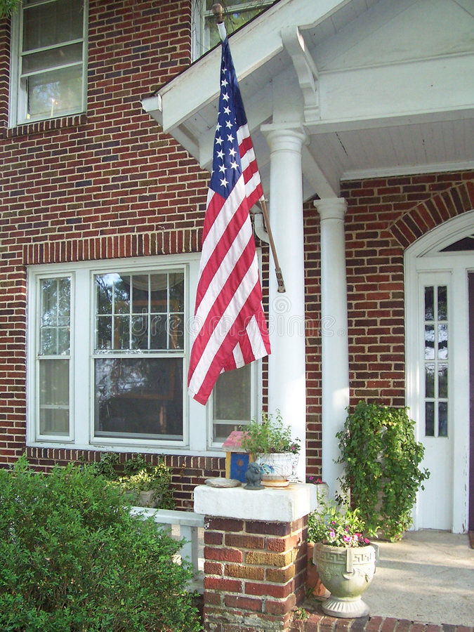 American flag on porch stock photography