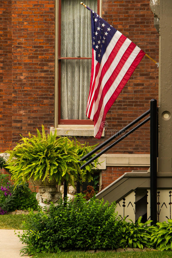 American Flag on Porch stock images